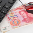 Computer mouse and chinese currency — Stock Photo