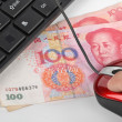 Computer mouse and chinese currency — Stock Photo #8664764