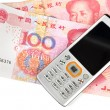 Mobile phone and chinese currency — Stock Photo #8703220
