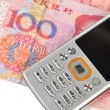 Mobile phone and chinese currency — Stock Photo #8703296
