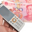 Mobile phone and chinese currency — Stock Photo #8703416