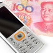 Stock Photo: Mobile phone and chinese currency