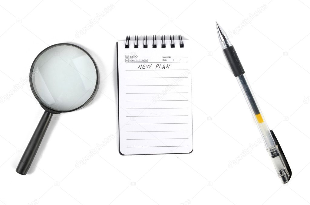 Magnifier and notepad with pen — Stock Photo #8772538