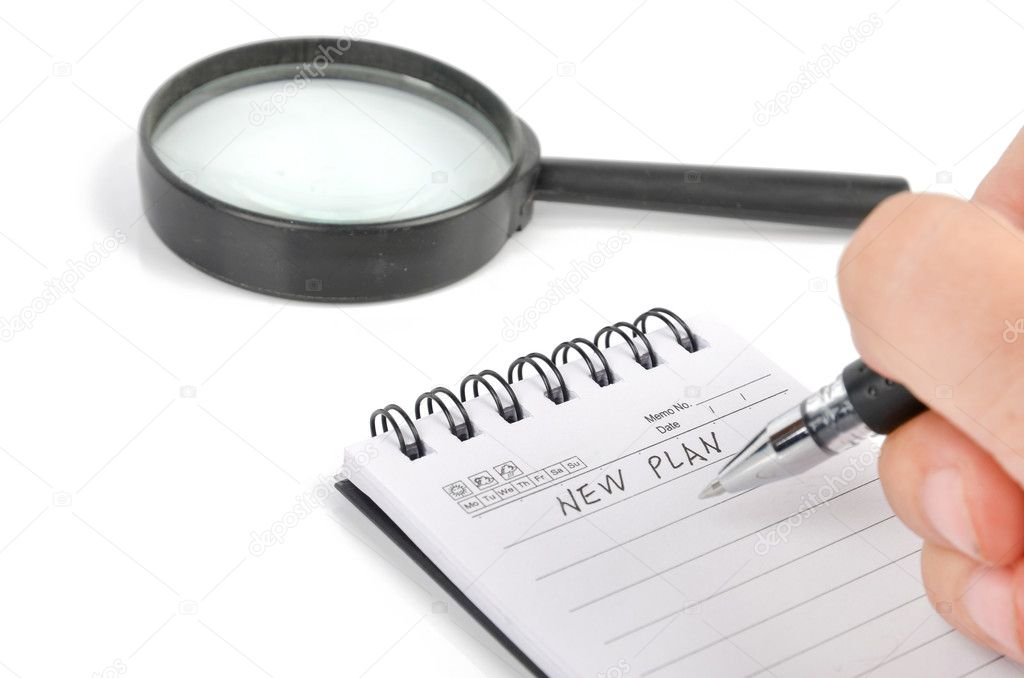 Magnifier and notepad with pen — Stock Photo #8772631