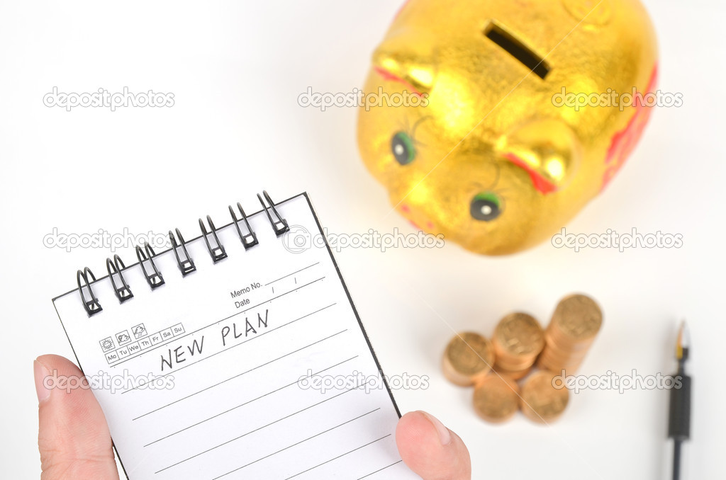 Piggy bank and notepad with pen on white background — Stock Photo #8837126