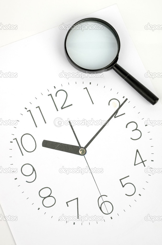 Clock face and magnifier on white background  Stock Photo #8873927