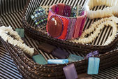Costume jewelry in basket — Stockfoto