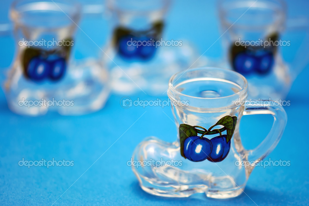 Set of dram glass on blue background — Stock Photo #8815599
