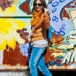 Woman at graffitti wall — Stock Photo #9544985