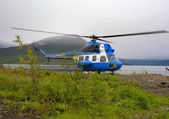 The helicopter in mountains — Stock Photo