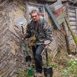Man with metal detector in the abandoned village. — Stock Photo