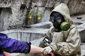 Person in gas mask with syringe — Stock Photo