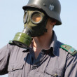 German soldier in gas mask . — Stock Photo
