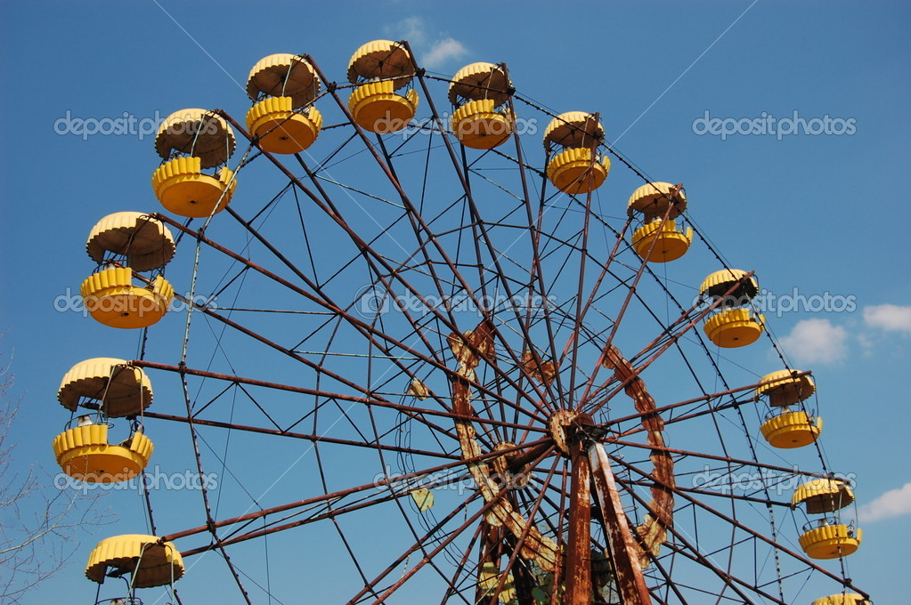 Abandoned ferris wheel in amusement park in Pripyat, Chernobyl area   Stock Photo #8563333