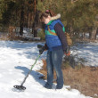 Stock Photo: Girl teenager with metal detector in forest at early spring