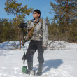 Man with metal detector in the forest at  early spring — Stock Photo