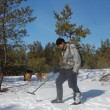 Stock Photo: Mwith metal detector in forest at early spring