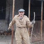 Gardener with machete — Stock Photo #9825361