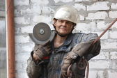 Man with angular electric grinder — Stock Photo