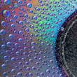 Stock Photo: Watter drops on cd