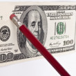 Stock Photo: Erasing hundred dollar