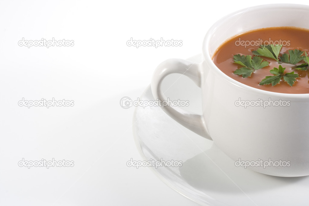 Tomato soup half view on white background — Stock Photo #8380253