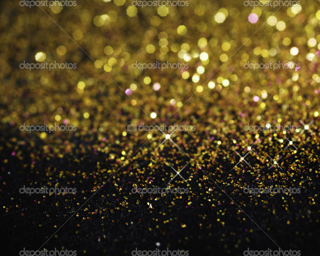 Gold glitter on black background — Stock Photo ...
