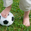 Childs Feet on Football — Stock Photo #8412143