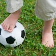 Childs Feet on a Football — Stock Photo #8412143