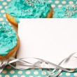 Cupcakes with a blank invitation — Stock Photo #8992391