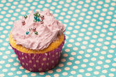 Cupcake wil polka dots — Stock Photo