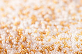 Gold sugar pearls — Stock Photo