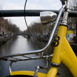 Stock Photo: Close up of yellow bicycle at amsterdam