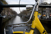The close up of yellow bicycle at amsterdam — Stock Photo