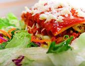 Close up of Lasagana with salad — Stock Photo