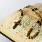 Rosary beads and breviary — Stock Photo #8444441