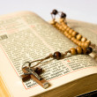Stock Photo: Rosary beads and breviary
