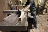 Carpenter using electric saw — Stock Photo
