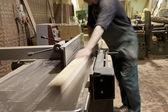 Carpenter using electric saw — Photo