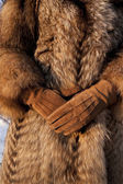 Wearing fur coat and gloves in cold winter — Stock Photo