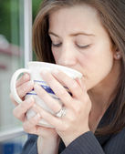 Woman sipping coffee — Stock Photo