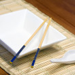 Chopsticks on plate — Stock Photo