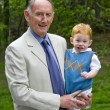 Stock Photo: Grandad with grandson