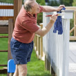 Man painting fence — Stock Photo