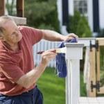 Man painting fence — Stock Photo #8406540