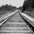 Train tracks in black and white — Stock Photo
