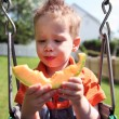 Boy eating melon — Stock Photo #8408368