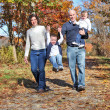 Happy family walking - Stock Photo