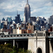 Manhattan bridge and Empire State Building - Stock Photo