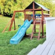 Stock Photo: Wooden playset in backyard